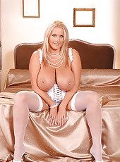Blonde babe Laura M posing on bed