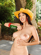 Busty Angelik spilling beer on tits