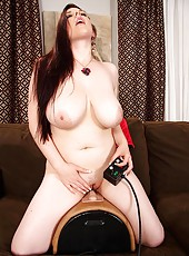 Busty chick riding a sybian wild