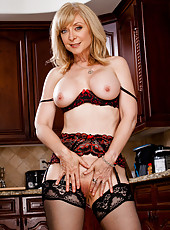 Sexy MILF Nina Hartley teaches her son a lesson by fucking his friend.