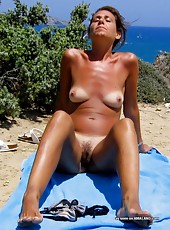 Fit sleazy MILF shows off her pussy