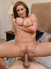 Busty brunette MILF has sex with big cock.