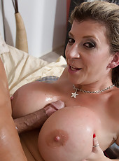 Busty big breasted MILF fucks younger guy to orgasm.