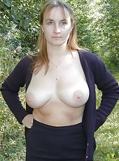 Big-tittied MILF posing naked