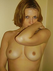 Wife in lingerie posing for hubby