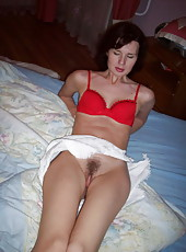 Horny mom naked and spreading her legs