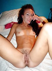 Horny brunette MILF naked and posing