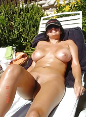 Busty brunette housewife posing naked
