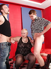 Young studs skewering a chunky old bitch with their cocks