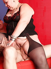 Shorthaired mature fatty sucks a boy stiff and rides him