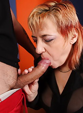 Mom doing her best to take a young cock as deep as she can