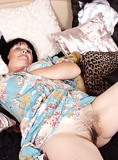 Hot old woman wears lingerie and uses rubber cock