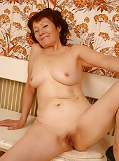 Cute old woman shows her perfect shaven pussy