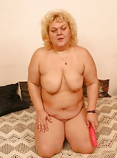 Big old woman spreads legs and plays with dildo