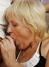 Lovely old woman tastes young dick and gets wild