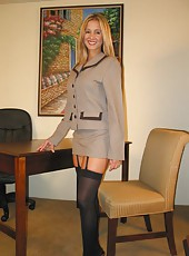 Rio posing for her boss in her business suit and sexy black lingerie