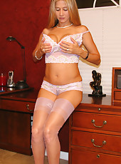 Rio in her office showing off her pink lingerie