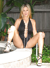 Rio posing by her pool in a very sexy bikini and high heels