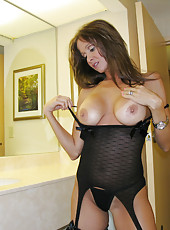 HotWifeRio posing in sexy lingerie for her husband at a hotel