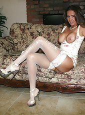 HotWifeRio puts on a pair of white stockings then jerks off one of her fans