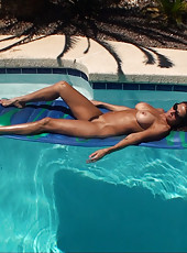 HotWifeRio gets some sun while laying out nude showing off her hairy pussy