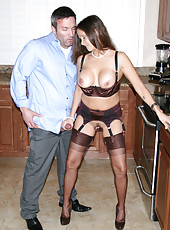 HotWifeRio puts on a pair of stockings and garters then sucks off a fans cock