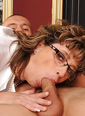 Lusty grandma is fucking with a young lucky boy