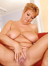 Lusty granny fucking a girl with a strap-on dildo