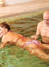 Horny old couple is fucking in the swimming pool