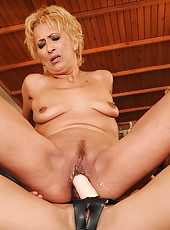 Granny fucked by young girl with a strap-on dildo