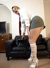 Big ass Milf in her naughty schoolgirl uniform