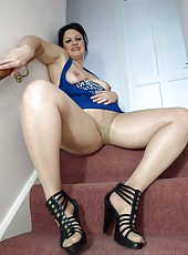 Pantyhose clad English milf showing of her cunt on the stairs
