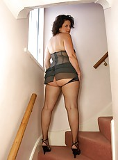 Curvy big butt milf Daniella in sexy pinstripe lingerie and fishnets