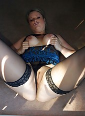 Slutty big ass MILF in stockings spreads at her back door
