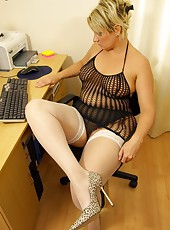 Big ass secretary in saucy fishnet dress and stockings