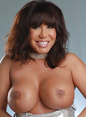 Look how my nice big tits look in the silver teddy. They don