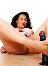 Danica performs a bare feet footjob on her toy
