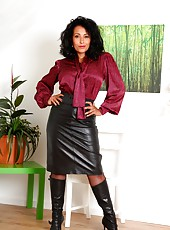 Danica in leather skirt, pantyhose and boots