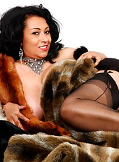 Danica in stockings surrounded by fur