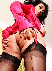 Danica strips down to her stockings in the office