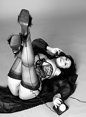 Danica Collins in corset and stockings in retro black and white set