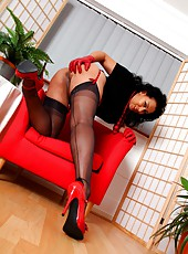 Danica pulls down her panties to masturbate in red leather gloves
