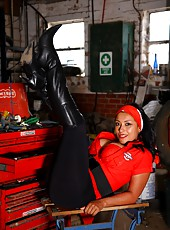 Danica Collins getting a good service in black leggings and boots