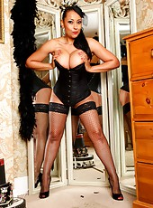 Danica Collins in black corset and fishnet stockings