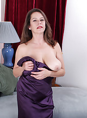 Busty brunette Christy from AllOver30 swinging her bangers in here