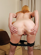 Blonde and 57 year old Pam from AllOver30 slips out of her lingerie