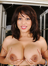 Busty and exotic Lala Bond from AllOver30 squeezes her big juicy tits