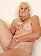 Returning home from work 52 year old Sindy Silver relaxes in the buff