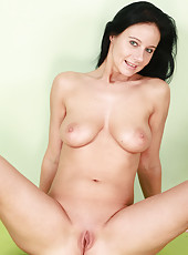 32 year old Enza from AllOver30 strips her bikini and spreads pussy