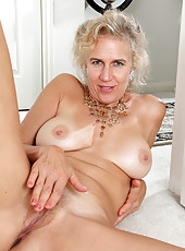 54 year old Sabrina from AllOver30 slips out of her black lingerie